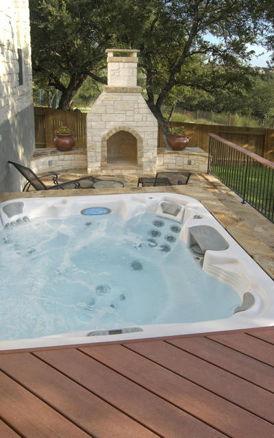 Hot tub deck and outdoor fireplace combo.