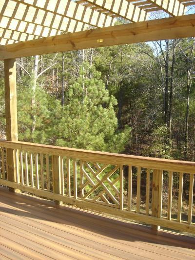 Chippendale patterned wood railings mixed with straights on composite deck in Macon GA