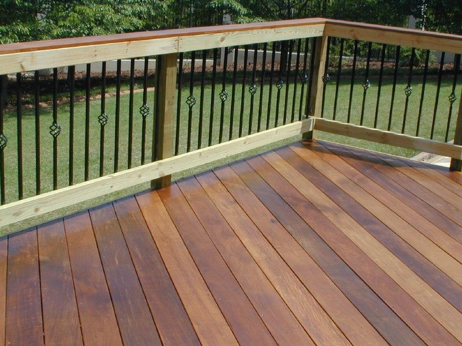 Ipe deck in Fortsyth GA with wooden rail and metal pickets with basket motif and Ipe cap