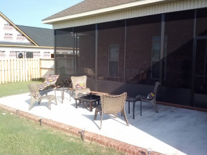 Warner Robins GA concrete patio with brick paver ribbon