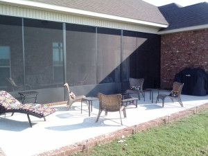 Warner Robins-concrete patio with brick surround
